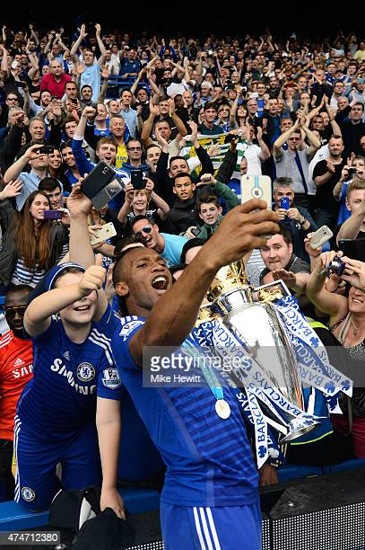 Didier Drogba of Chelsea celebrates with fans and the trophy after the Barclays Premier League match between Chelsea and Sunderland at Stamford...