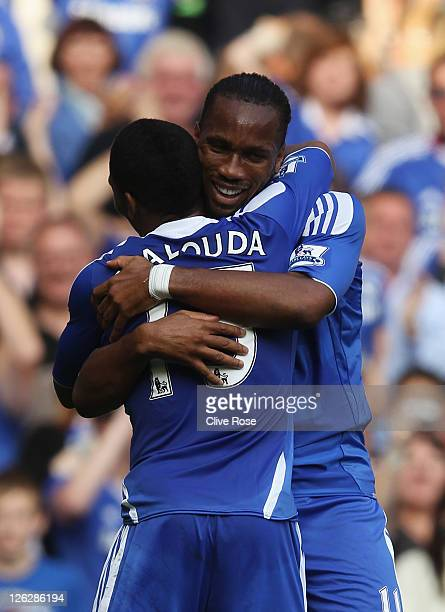 Didier Drogba of Chelsea celebrates with Florent Malouda as he scores their fourth goal during the Barclays Premier League match between Chelsea and...