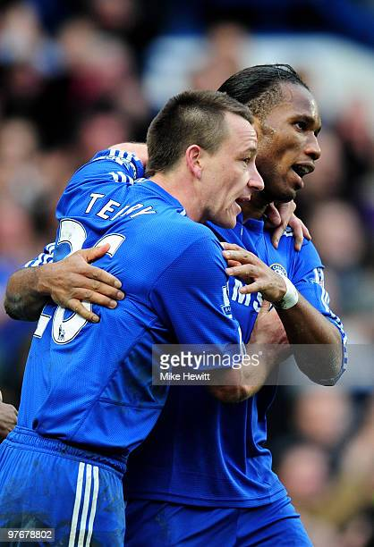 Didier Drogba of Chelsea celebrates with his captain John Terry after scoring his team's fourth goal during the Barclays Premier League match between...