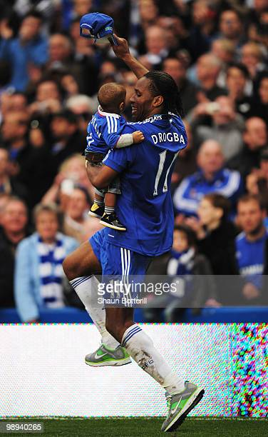 Didier Drogba of Chelsea celebrates with his son Keyran as he wins the title after the Barclays Premier League match between Chelsea and Wigan...