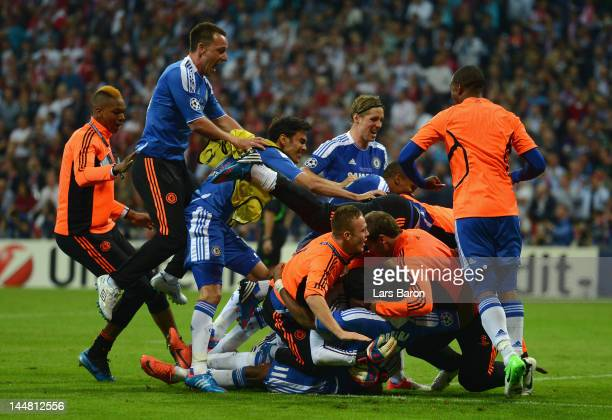 Didier Drogba of Chelsea celebrates with team mates after scoring the winning penalty during UEFA Champions League Final between FC Bayern Muenchen...