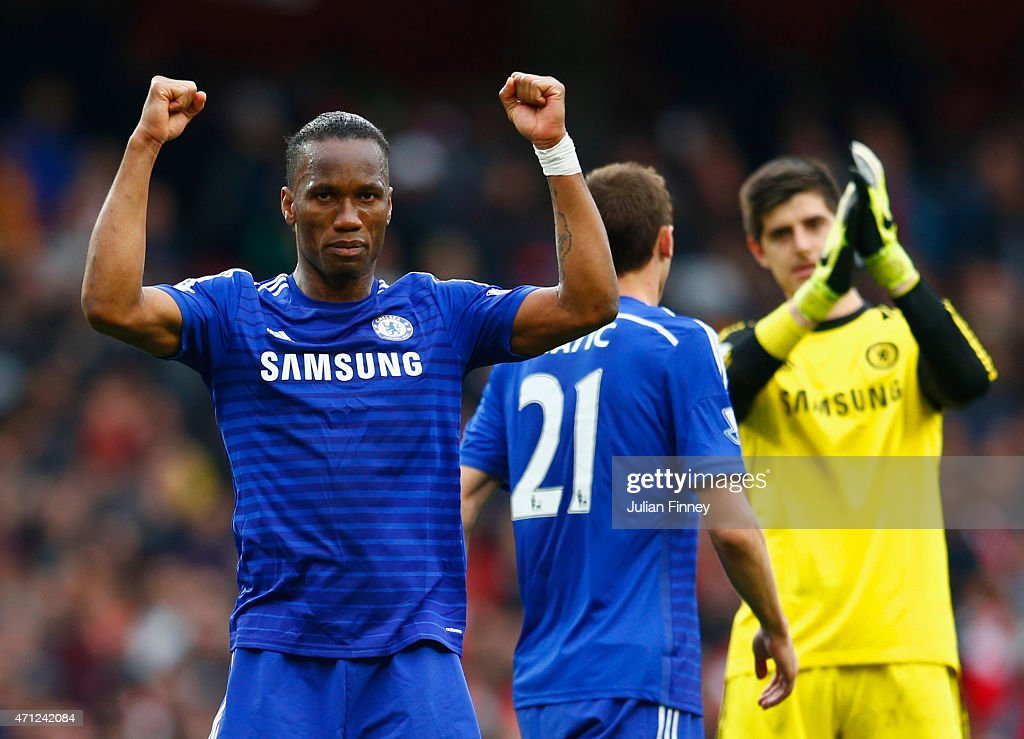Didier Drogba of Chelsea celebrates with team mates after the Barclays Premier League match between Arsenal and Chelsea at Emirates Stadium on April 26, 2015 in London, England.