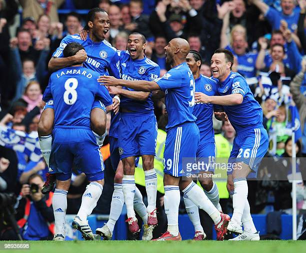 Didier Drogba of Chelsea celebrates with team mates as he scores their fifth goal during the Barclays Premier League match between Chelsea and Wigan...