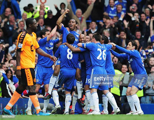 Didier Drogba of Chelsea celebrates with team mates as he scores their fifh goal during the Barclays Premier League match between Chelsea and Wigan...