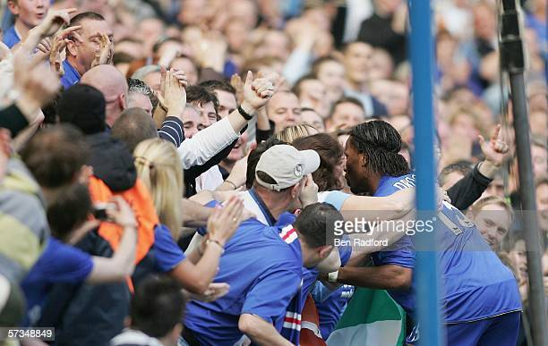 Didier Drogba of Chelsea celebrates with the crowd as he scores the second goal during the Barclays Premiership match between Chelsea and Everton at...