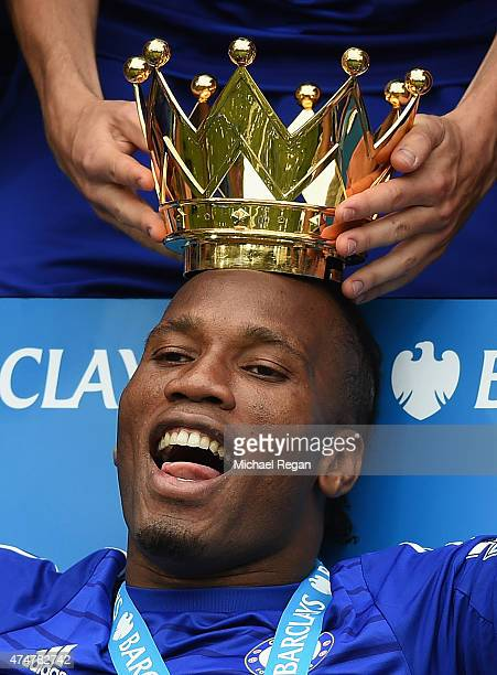 Didier Drogba of Chelsea celebrates with the Premier League trophy at Stamford Bridge on May 24 2015 in London England