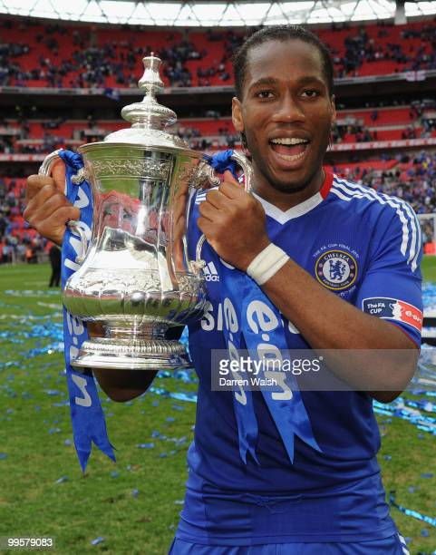 Didier Drogba of Chelsea celebrates with the trophy at the end of the FA Cup sponsored by E.ON Final match between Chelsea and Portsmouth at Wembley...