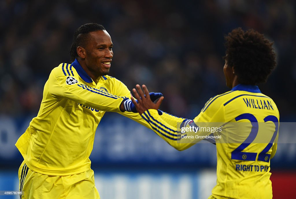 Didier Drogba of Chelsea (L) celebrates with Willian of Chelsea as he scores their fourth goal during the UEFA Champions League Group G match between FC Schalke 04 and Chelsea FC at Veltins-Arena on November 25, 2014 in Gelsenkirchen, Germany.