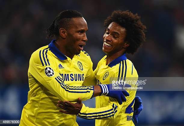 Didier Drogba of Chelsea celebrates with Willian of Chelsea as he scores their fourth goal during the UEFA Champions League Group G match between FC...