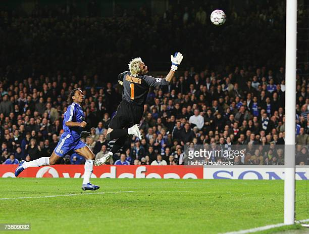 Didier Drogba of Chelsea chips the ball over Goalkeeper Santiago Canizares of Valencia to score his teams second goal during the UEFA Champions...