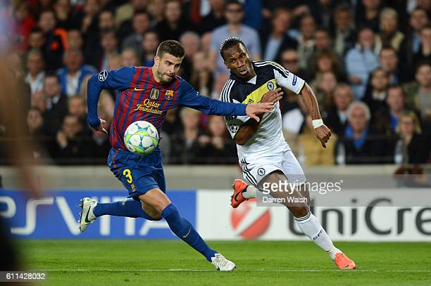 Didier Drogba of Chelsea clashes with Gerard Pique of Barcelona during the UEFA Champions League Semi Final second leg match between FC Barcelona and...
