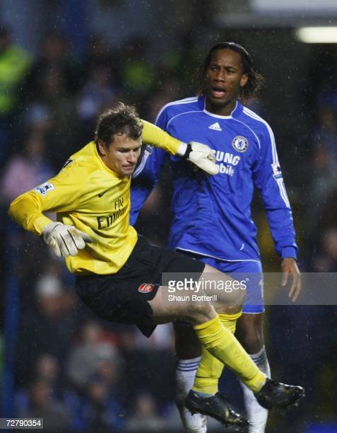 Didier Drogba of Chelsea clashes with Jens Lehmann of Arsenal during the Barclays Premiership match between Chelsea and Arsenal at Stamford Bridge on...