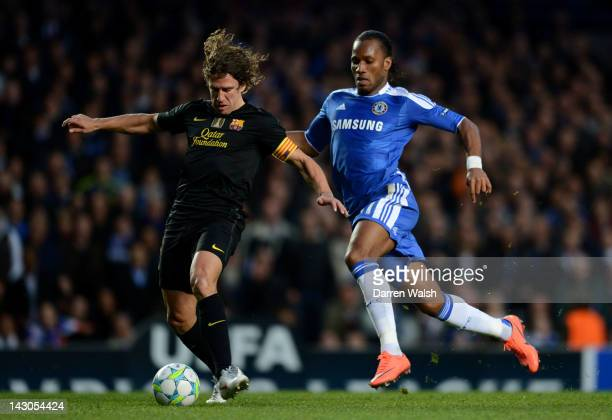 Didier Drogba of Chelsea closes down Carles Puyol of Barcelona during the UEFA Champions League Semi Final first leg match between Chelsea and...