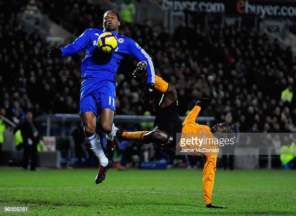Didier Drogba of Chelsea competes for the ball with George Boateng of Hull City during the Barclays Premier League match between Hull City and...