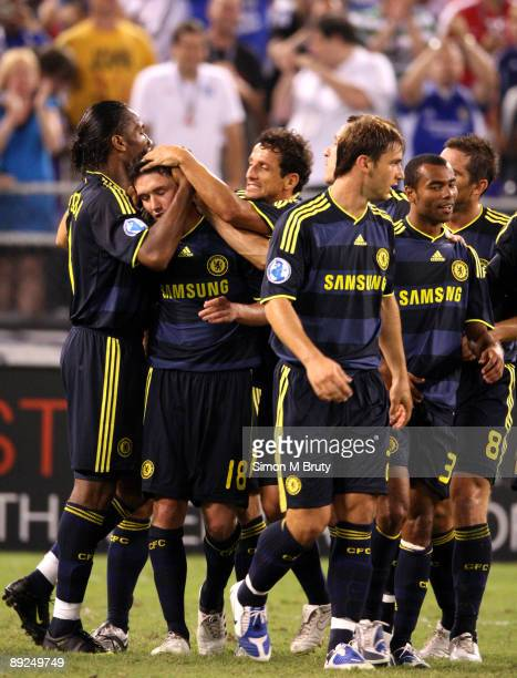 Didier Drogba of Chelsea congratulates Yuri Zhirkov on scoring the second Chelsea goal during the pre-season friendly match between AC Milan and...