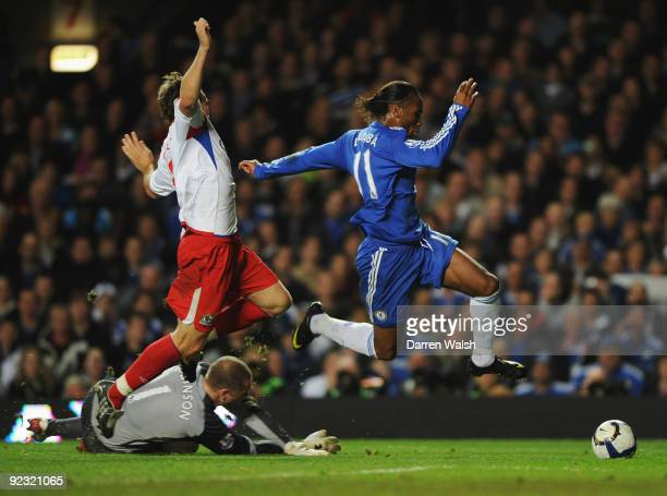 Didier Drogba of Chelsea evades Gael Givet and Paul Robinson of Blackburn Roversduring the Barclays Premier League match between Chelsea and...