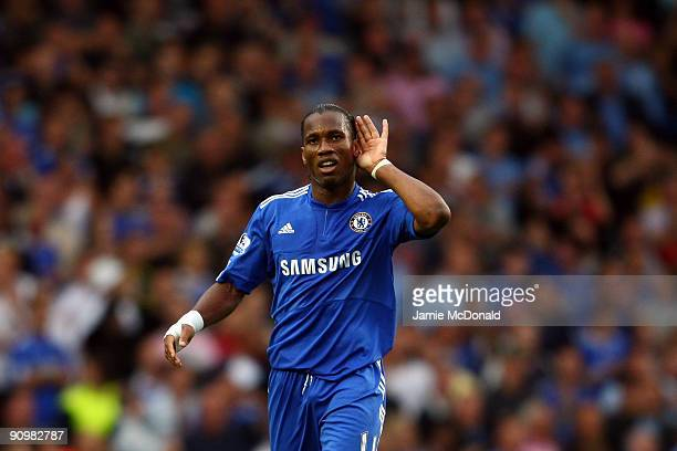 Didier Drogba of Chelsea gestures to the crowd after he scored during the Barclays Premier League match between Chelsea and Tottenham Hotspur at...