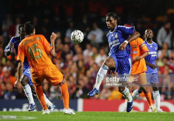 Didier Drogba of Chelsea goes past Edmilson of Barcelona during the UEFA Champions League Group A match between Chelsea and Barcelona at Stamford...