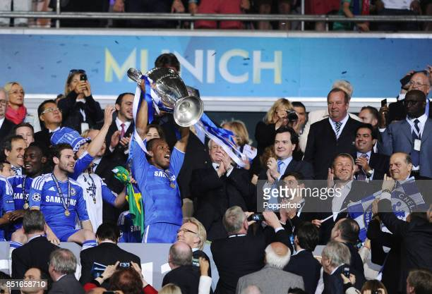 Didier Drogba of Chelsea hands the European Cup to club owner Roman Abramovich after they win the UEFA Champions League Final between FC Bayern...