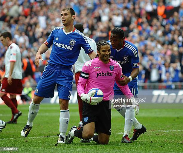 Didier Drogba of Chelsea has a word with goalkeepr David James of Portsmouth during the FA Cup sponsored by EON Final match between Chelsea and...