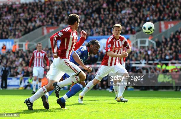 Didier Drogba of Chelsea heads home the equalising goal during the Barclays Premier League match between Stoke City and Chelsea at Britannia Stadium...