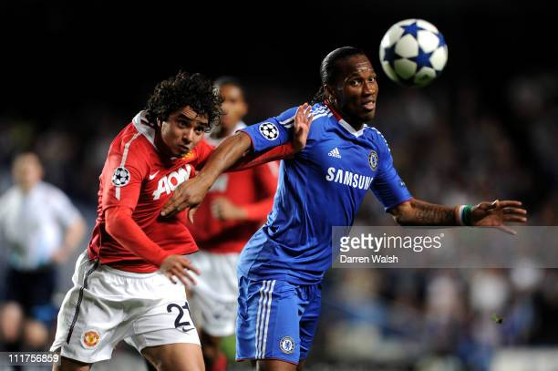 Didier Drogba of Chelsea holds off the challenge from Rafael of Manchester United during the UEFA Champions League quarter final first leg match...