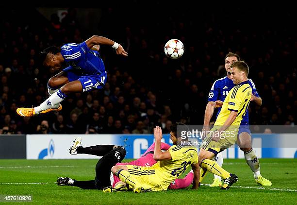 Didier Drogba of Chelsea hurdles over goalkeeper Jasmin Handanovic of Maribor during the UEFA Champions League Group G match between Chelsea FC and...