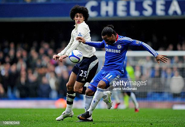 Didier Drogba of Chelsea is challenged by Marouane Fellaini of Everton during the FA Cup sponsored by EON 4th round replay match between Chelsea and...