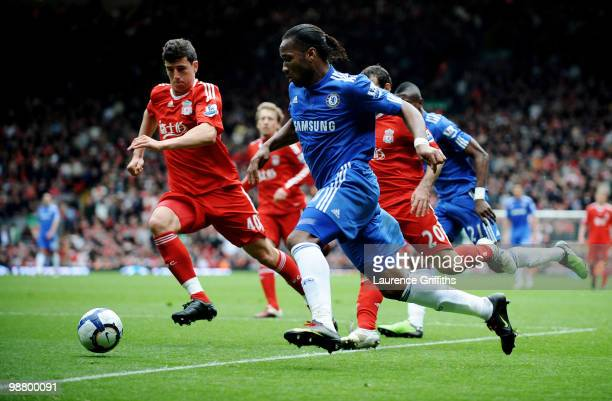 Didier Drogba of Chelsea is closed down by Daniel Ayala of Liverpool during the Barclays Premier League match between Liverpool and Chelsea at...