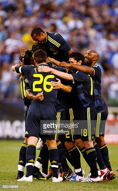 Didier Drogba of Chelsea is congratulated by team mates after scoring the first goal during the pre-season friendly match between AC Milan and...
