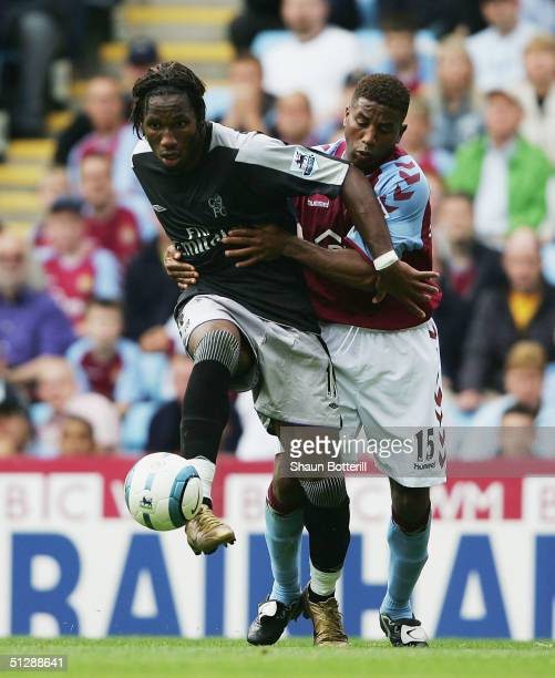 Didier Drogba of Chelsea is held back by Ulises De La Cruz of Aston Villa during the Barclays Premiership match at Villa Park on September 11 2004 in...