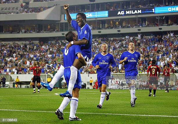Didier Drogba of Chelsea is lifted by teammate Frank Lampard after scoring a goal against AC Milan during the Championsworld Series game at Lincoln...