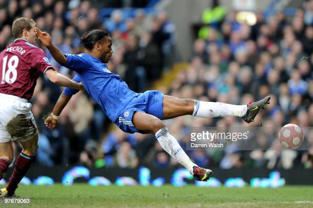Didier Drogba of Chelsea is pulled down in the area by Jonathan Spector of West Ham but play is waved on by the Referee Mark Clattenburg during the...