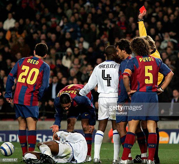 Didier Drogba of Chelsea is shown the red card for a second yellow for a foul on Goalkeeper Victor Valdes of Barcelona during the UEFA Champions...