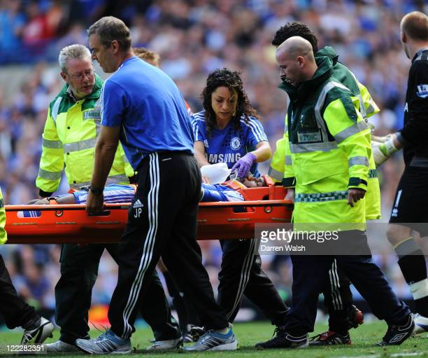 Didier Drogba of Chelsea is taken off the pitch on a stretcher to receive treatment after a collision with goalkeeper John Ruddy of Norwich City...