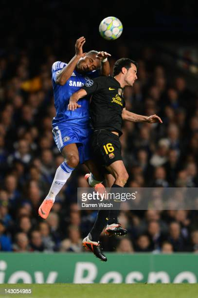 Didier Drogba of Chelsea jumps for a header with Sergio Busquets of Barcelona during the UEFA Champions League Semi Final first leg match between...