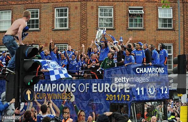 Didier Drogba of Chelsea lifts the Champions League trophy during the Chelsea victory parade following their UEFA Champions League and FA Cup...