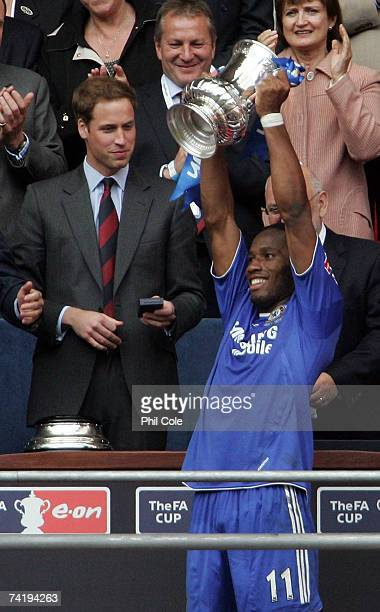 Didier Drogba of Chelsea lifts the FA Cup trophy as HRH Prince William looks on following the FA Cup Final match sponsored by E.ON between Manchester...