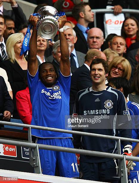 Didier Drogba of Chelsea lifts the FA Cup trophy following as Petr Cech looks on the FA Cup Final match sponsored by E.ON between Manchester United...