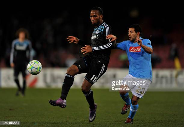 Didier Drogba of Chelsea passes as Walter Gargano of Napoli closes in during the UEFA Champions League round of 16 first leg match between SSC Napoli...