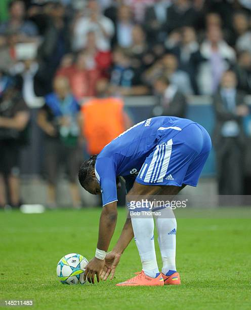 Didier Drogba of Chelsea places the ball prior to taking his match winning penalty kick during the UEFA Champions League Final between FC Bayern...