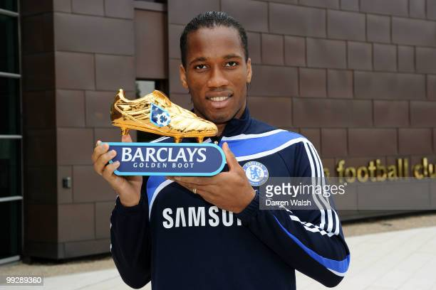 Didier Drogba of Chelsea poses with the Barclays Golden Boot award after a training session at the Cobham Training ground on May 13, 2010 in Cobham,...
