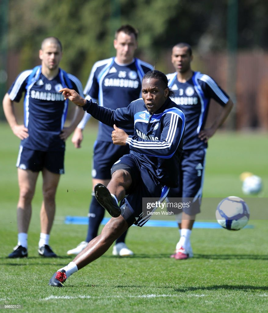 Didier Drogba of Chelsea practices his free kick during a training session at the Cobham Training Ground on April 23, 2010 in Cobham, England.