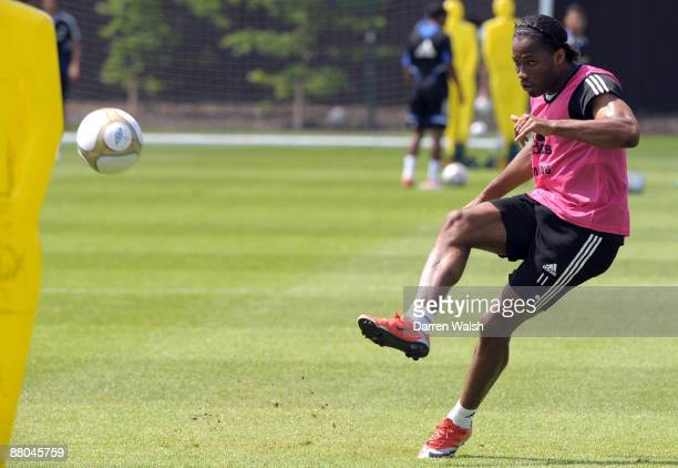 Didier Drogba of Chelsea practices his free kicks during a training session at the training ground on May 29 2009 in Cobham Surrey
