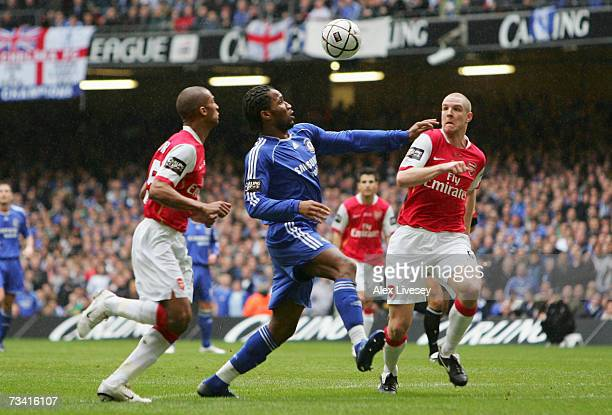 Didier Drogba of Chelsea pressurises the Arsenal defence during the Carling Cup Final match between Chelsea and Arsenal at the Millennium Stadium on...