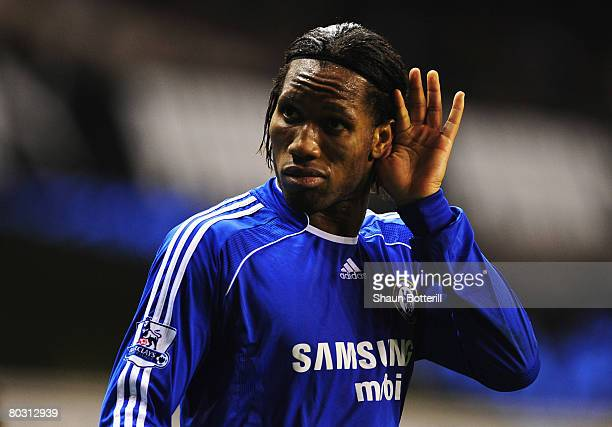 Didier Drogba of Chelsea puts his hand to his ear to listen to the Chelsea fans sing during the Barclays Premier League match between Tottenham...