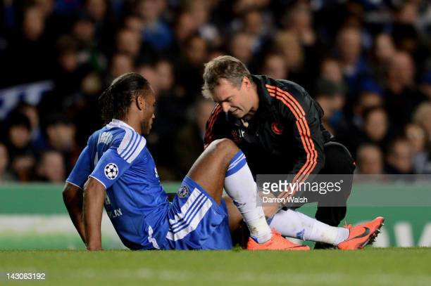 Didier Drogba of Chelsea receives medicak treatment during the UEFA Champions League Semi Final first leg match between Chelsea and Barcelona at...