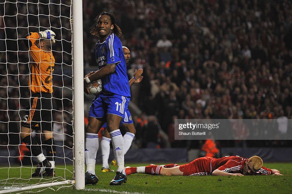 Didier Drogba of Chelsea retrieves the ball after John Arne Riise of Liverpool scored an own goal during the UEFA Champions League Semi Final, first leg match between Liverpool and Chelsea at Anfield on April 22, 2008 in Liverpool, England.
