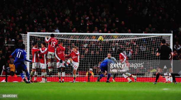 Didier Drogba of Chelsea scores his second goal during the Barclays Premier League match between Arsenal and Chelsea at the Emirates Stadium on...