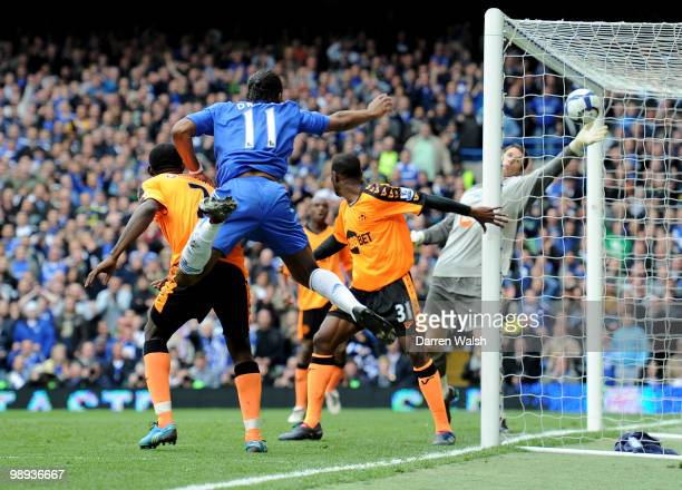 Didier Drogba of Chelsea scores his team's fifth of the match and his club's 100th of the season during the Barclays Premier League match between...